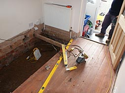 Removing the floorboards and joist.