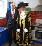 Dean Raven and the Lord Major of Birmingham in the Lego kitchen at Princethorpe Infant and Junior School