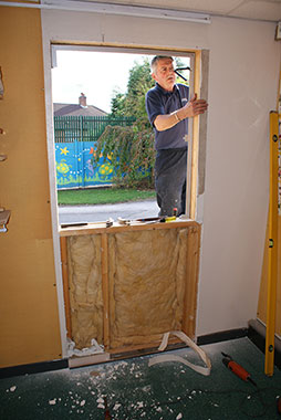 Removal of the existing wall and installation of fire door frame.