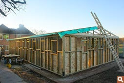 The timber building during roof insulation stage Woodfellas